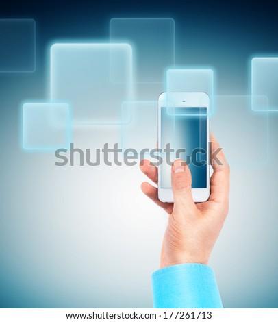 Hand holding Multimedia smartphone - stock photo