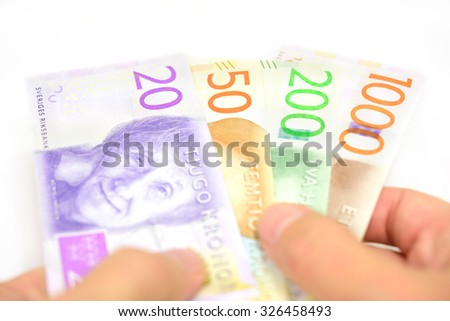 Hand holding new Swedish bank notes fanned out. NOTE: the new 2015 model. - stock photo