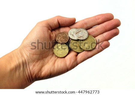 Hand holding New Zealand currency - the money is in coins. Isolated against a white background. - stock photo
