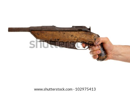 Hand holding old handmade shotgun isolated on white background - stock photo