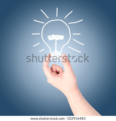 Hand holding on hand draw light bulb. Concept for new idea - stock photo