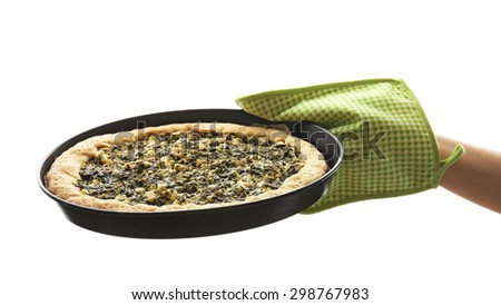 Hand holding open pie with spinach isolated on white - stock photo