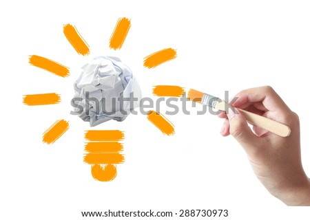 Hand holding painting brush is drawing Light bulb on white background. - stock photo