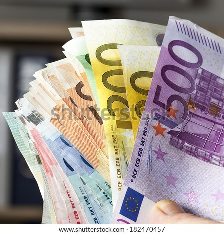 Hand holding paper money - stock photo