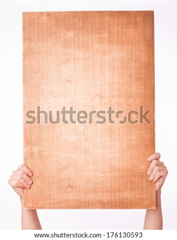 hand holding paper sheet over white background - stock photo
