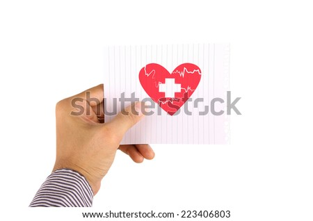 Hand holding paper with first aid sign - stock photo