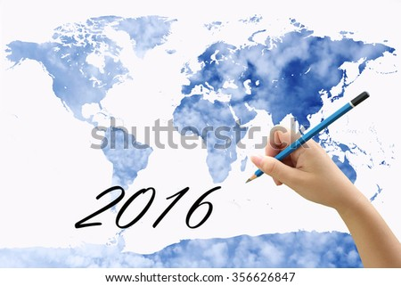 hand holding pencil on world map with blur cloud spread on blue sky background - stock photo
