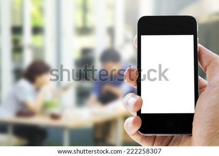hand holding phone on coffee cafe  background - stock photo