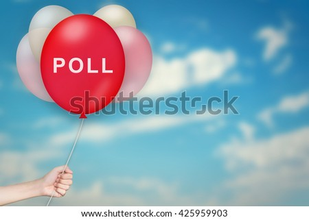 Hand Holding poll Balloon with sky blurred background - stock photo