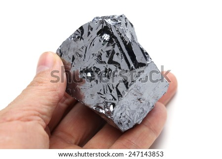 hand holding polycrystalline silicon, polysilicon - stock photo