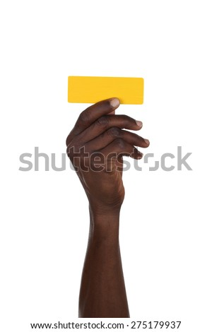 Hand holding punctuation mark hyphen or dash isolated on a white background - stock photo