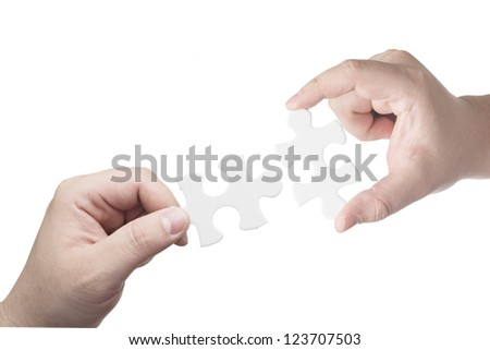 Hand holding puzzle piece trying to complete the puzzle. Concept for complete for business success - stock photo
