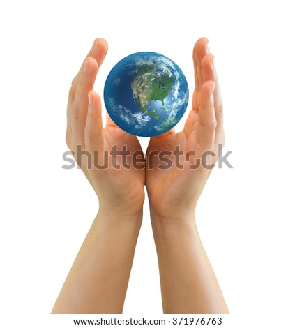 Hand holding realistic small globe symbolizing environmental care, facing North America - Elements of this image furnished by NASA - stock photo