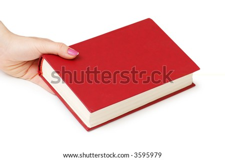 Hand holding red book isolated on white - stock photo