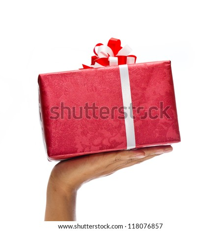 Hand holding red gift isolated on white background - stock photo