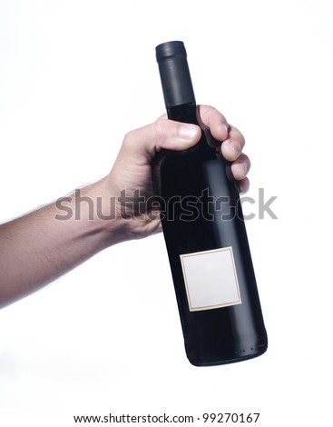 hand holding red wine bottle - stock photo