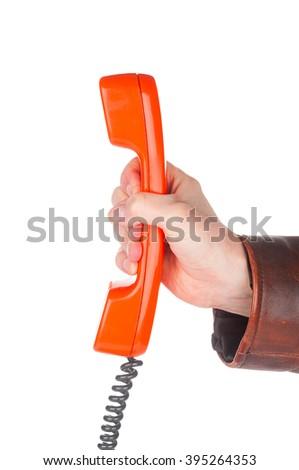 Hand holding retro telephone tube on white background - stock photo