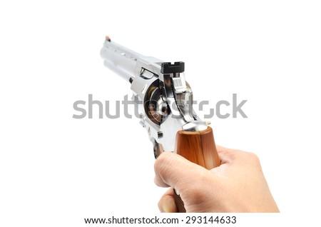 Hand holding Revolver (Pistol) - stock photo