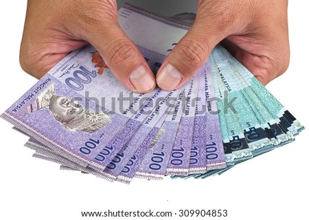 Hand Holding Ringgit Malaysia 100 and 50 - stock photo