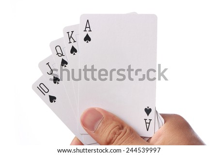 Hand holding royal straight flush playing cards poker. - stock photo