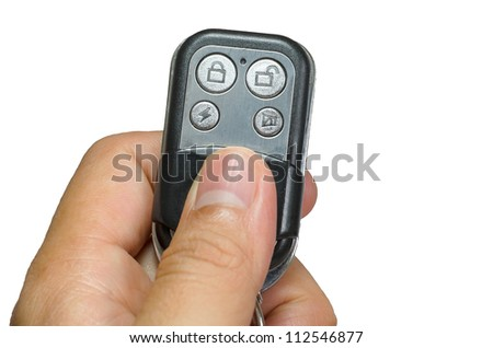 hand holding security remote control isolate on white background - stock photo