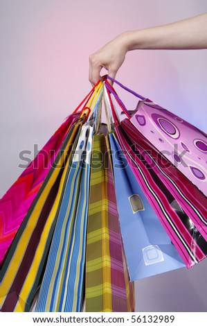 Hand holding shopping bags - stock photo