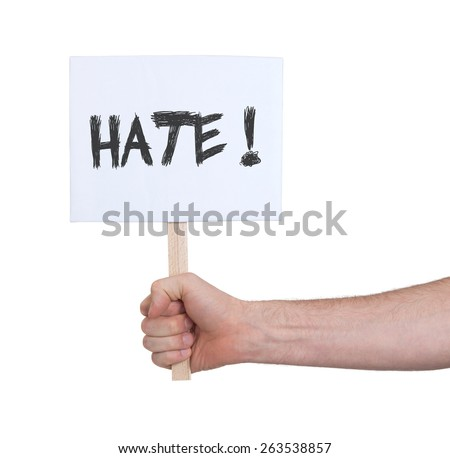 Hand holding sign, isolated on white - Hate - stock photo