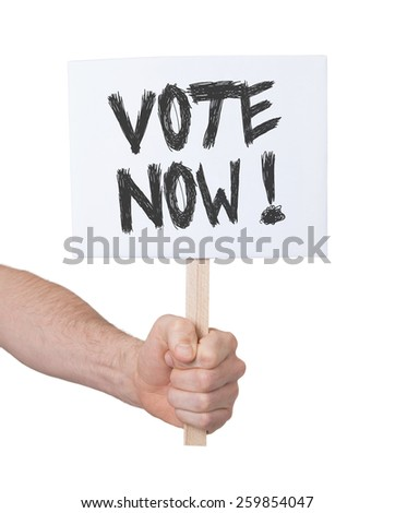 Hand holding sign, isolated on white - Vote now - stock photo