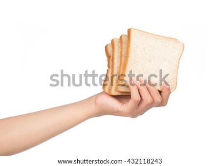Hand holding slice bread isolated on white background - stock photo