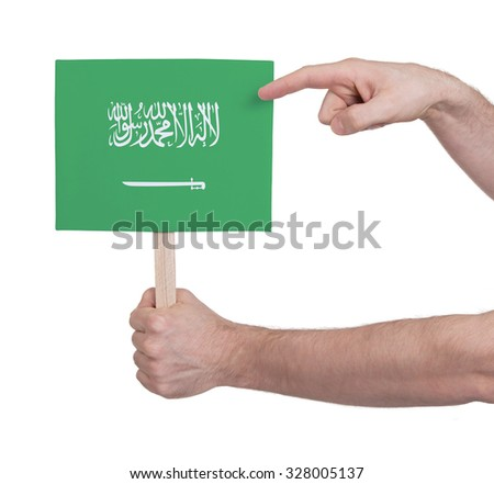 Hand holding small card, isolated on white - Flag of Saudi Arabia - stock photo