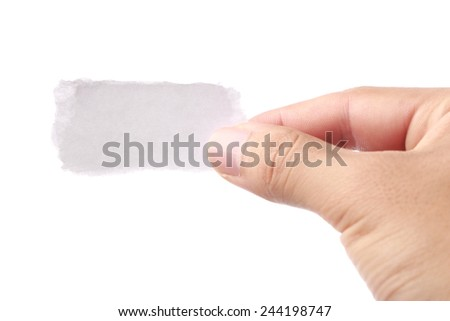 Hand holding small white paper isolated on white background. - stock photo