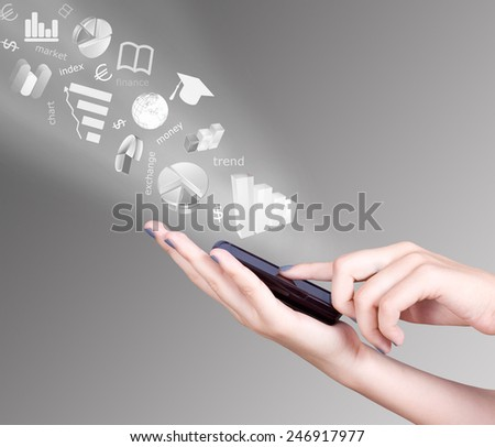 Hand holding smart mobile phone and exchange symbols flying away, Foreign exchange market concept.  Stock exchange concept - stock photo
