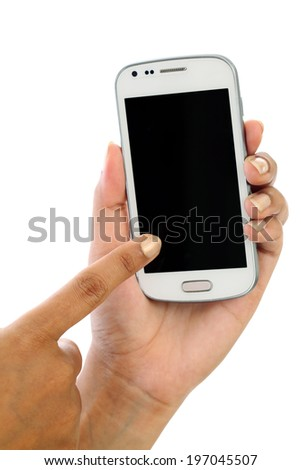 Hand holding smart phone against white background - stock photo