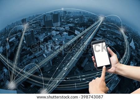 hand holding smart phone and city scape with network connection concept - stock photo
