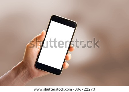 Hand holding smartphone device. - stock photo