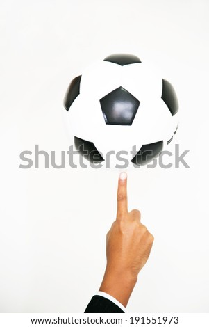 hand holding soccer ball isolated on white background  - stock photo