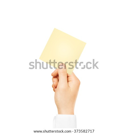 Hand holding square blank yellow sticker mock up isolated. Sticker mockup holder. Empty paper clue remnder hold in hands. Hand hold leaflet template. - stock photo
