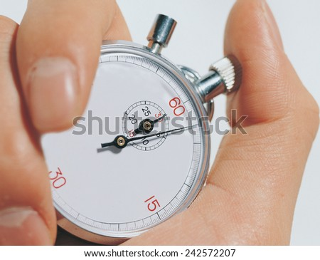 hand holding stopwatch - stock photo