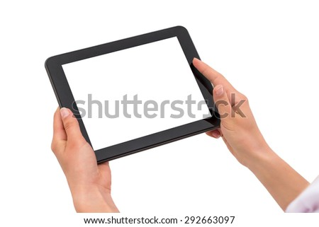 Hand holding tablet pc with touching hand. Isolated on white. - stock photo