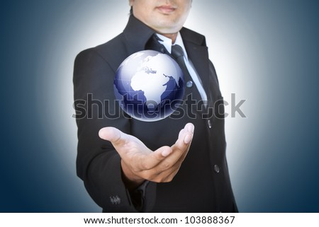 hand holding the business world - stock photo