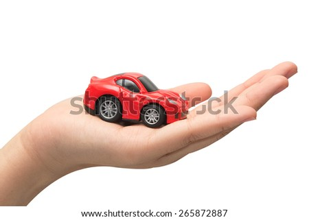 hand holding the model of car. symbol photo for car purchase - stock photo