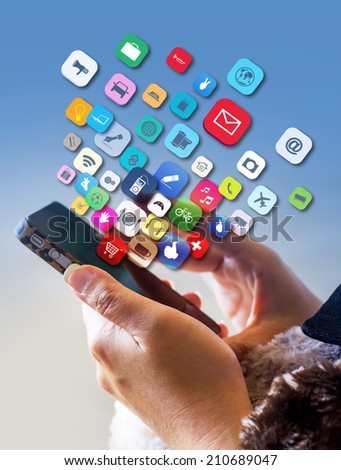 Hand holding the Smartphone with application icons  - stock photo