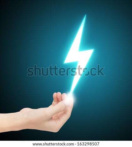 hand holding thunderbolt - stock photo