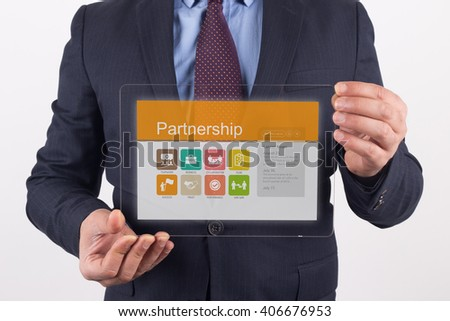 Hand Holding Transparent Tablet PC with Partnership screen - stock photo