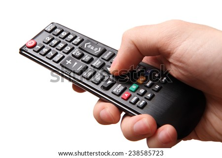 hand holding tv remote control - stock photo