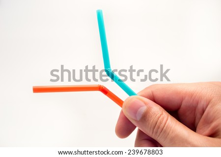 hand holding two straws to share a drink with his love - stock photo