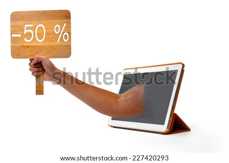 Hand holding up a cardboard 50 % sign  - stock photo