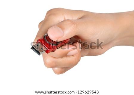 Hand holding USB device on white background - stock photo