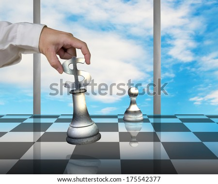Hand holding USD 3D symbol piece playing Chess with pawn on table and blue sky outside - stock photo