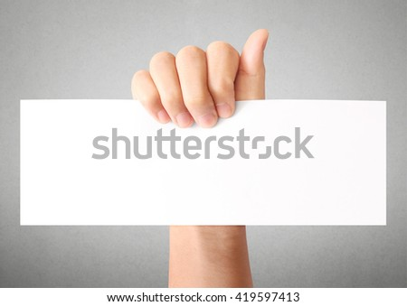 Hand holding white empty a paper - stock photo